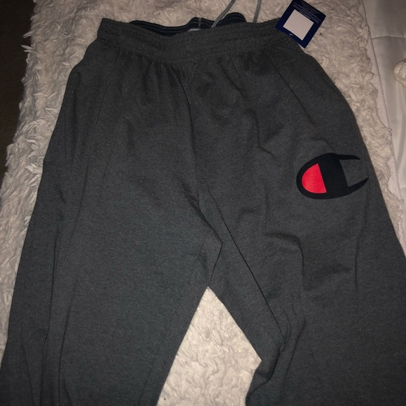 1bffa538567e Unisex - champion logo tapered sweat pants